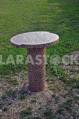 Oval granite table on a lawn