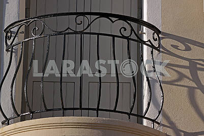 Stylish balcony with a metal forged railing