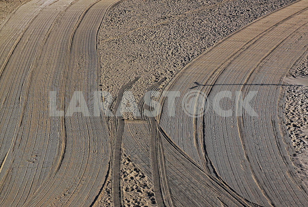 Cleaned by a tractor and people trampled sand on the Mediterrane — Image 69279
