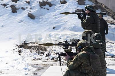 Servicemen of national guard at the shooting range