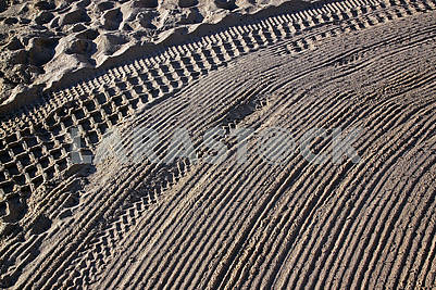 Cleaned by a tractor and people trampled sand on the Mediterrane