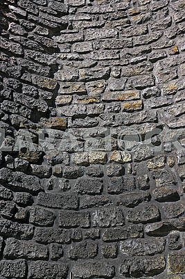 Old stone curved wall