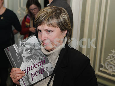 "A woman holds the book of Ada Rogovtseva ""Simple things"""