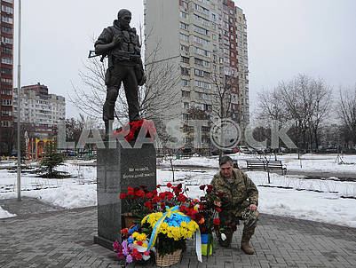 Laying flowers at the Volunteer Soldier Monument