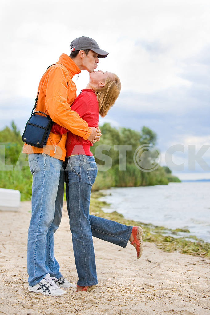 Young love Couple kissed on on coast of river. — Image 7005