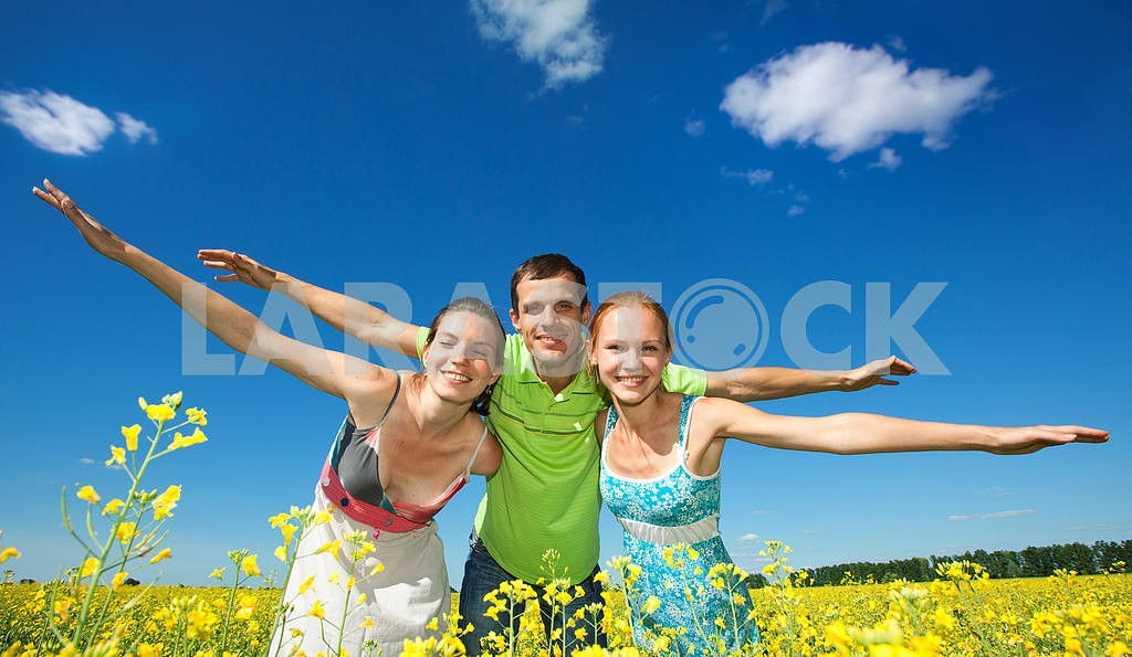 Happy people is jumping in field — Image 7032