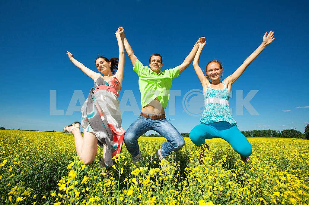 Happy people is jumping in field — Image 7035