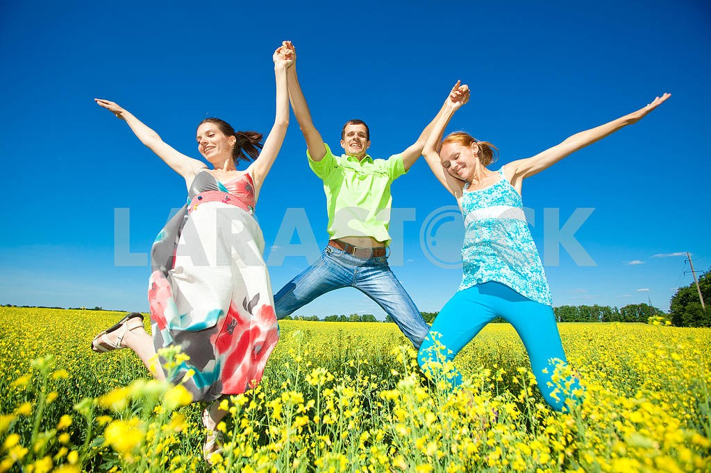Happy people is jumping in field — Image 7036