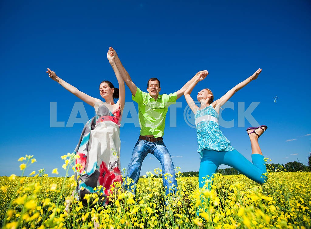 Happy people is jumping in field — Image 7038