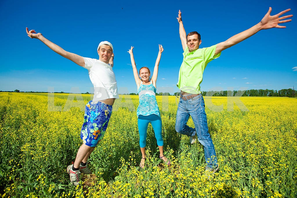 Happy people is jumping in field — Image 7042