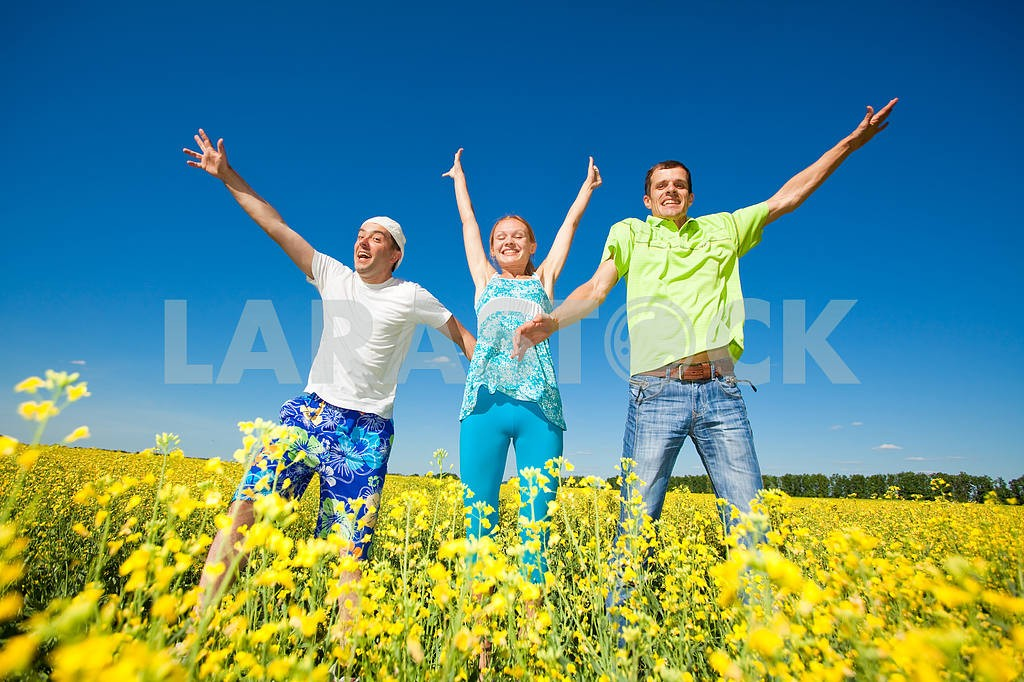Happy people is jumping in field — Image 7044