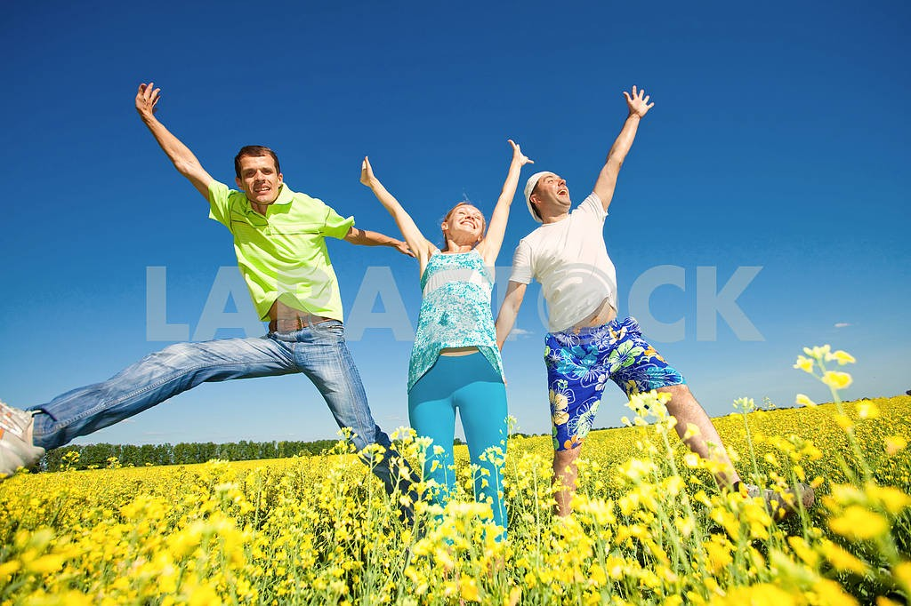 Happy people is jumping in field — Image 7045