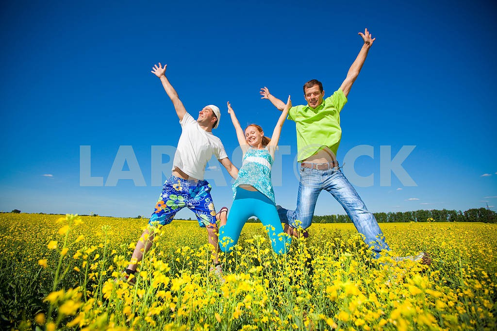 Happy people is jumping in field — Image 7046