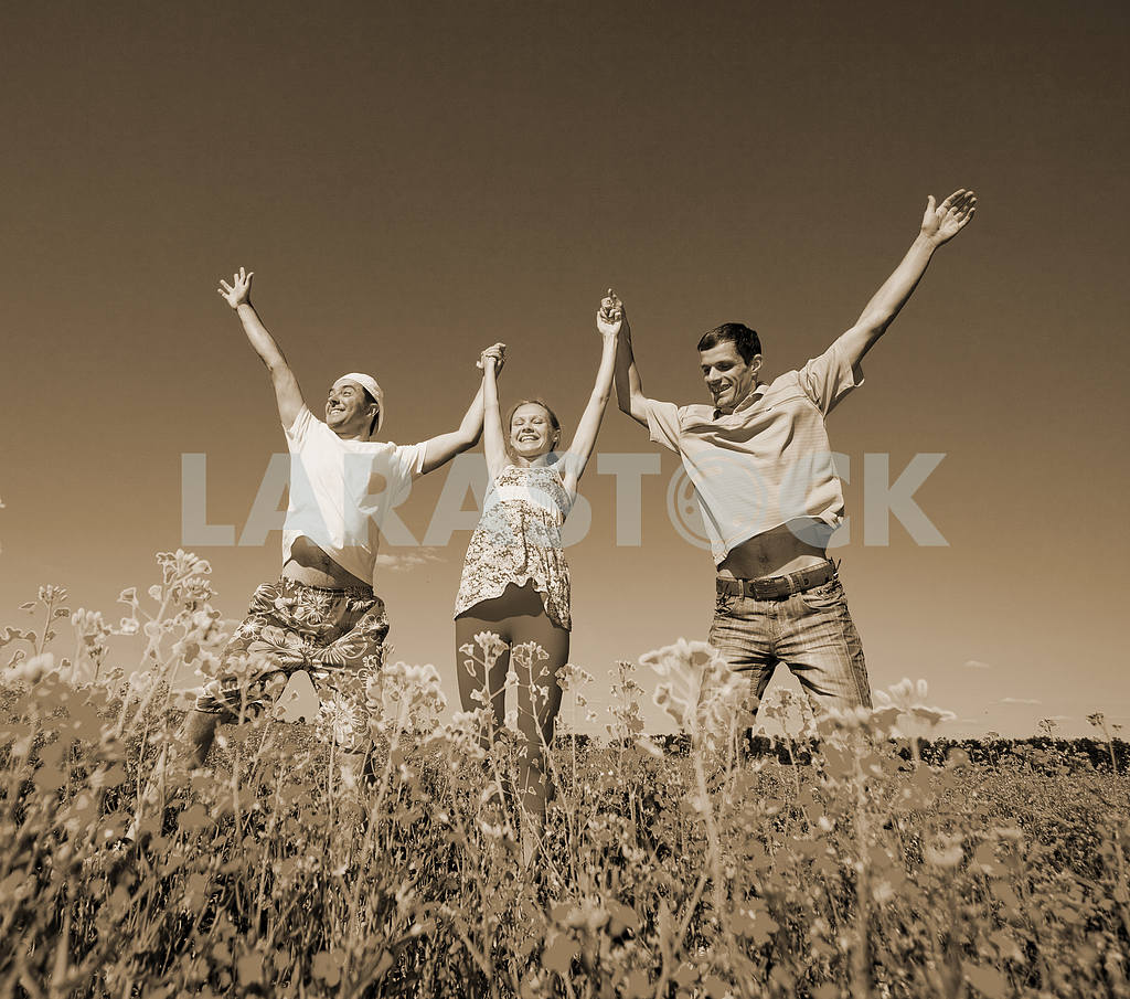Happy people is jumping in field — Image 7048