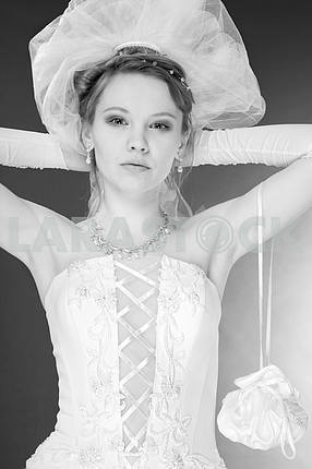 Concerns bride in the studio. In white dress. Isolated over blac