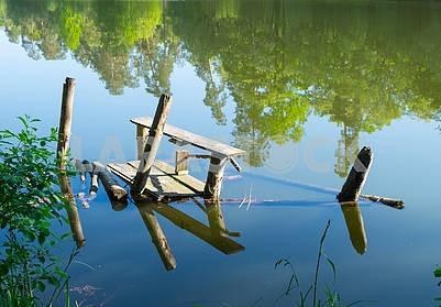Flooded fishing bridge in Pushcha Vodice