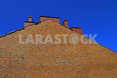 Hight rough brick wall