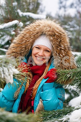 Girl in a snowy forest