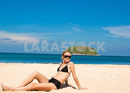 Happy young woman against azure sea