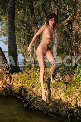 Naked girl on the lake