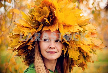 girl wearing a wreath of yellow autumn leaves