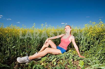 Pretty girl having fun in blue sky