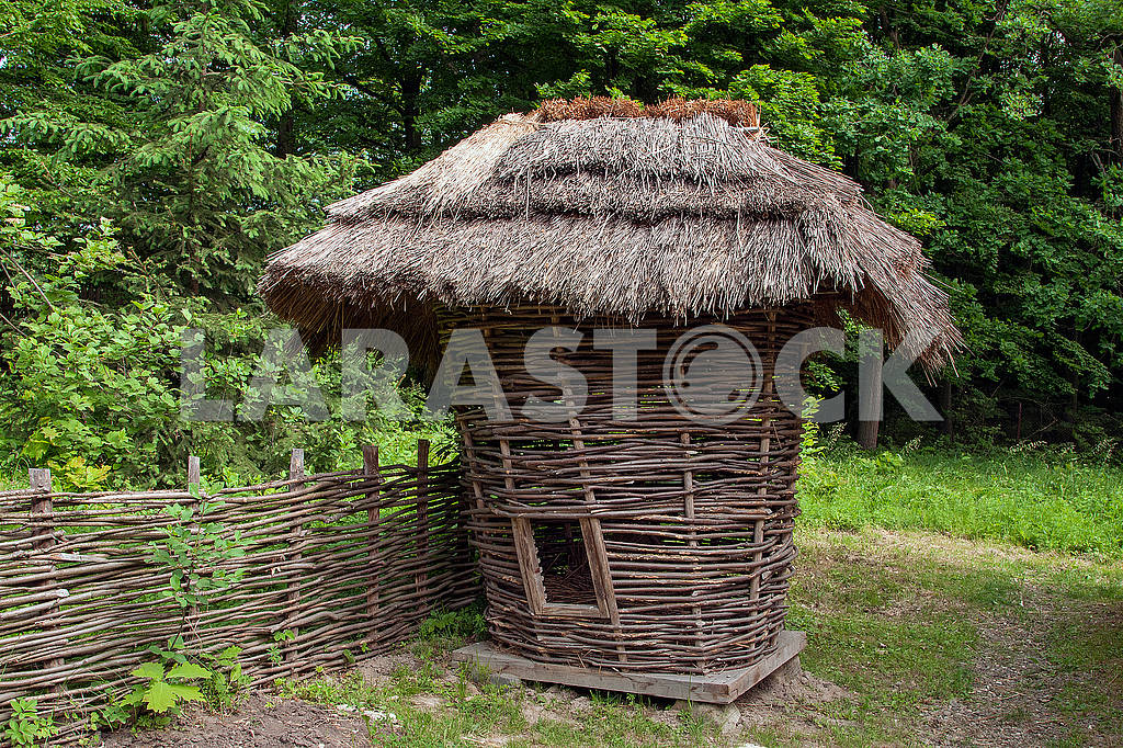 Traditional  corn drier shed for storing corn cobs in a peasant — Image 71536
