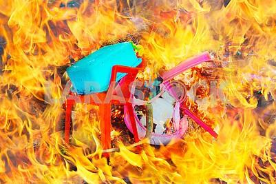 Burning plastic household