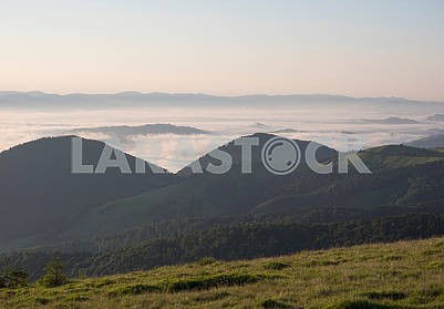 Clouds and peaks of mountains in the Carpathians