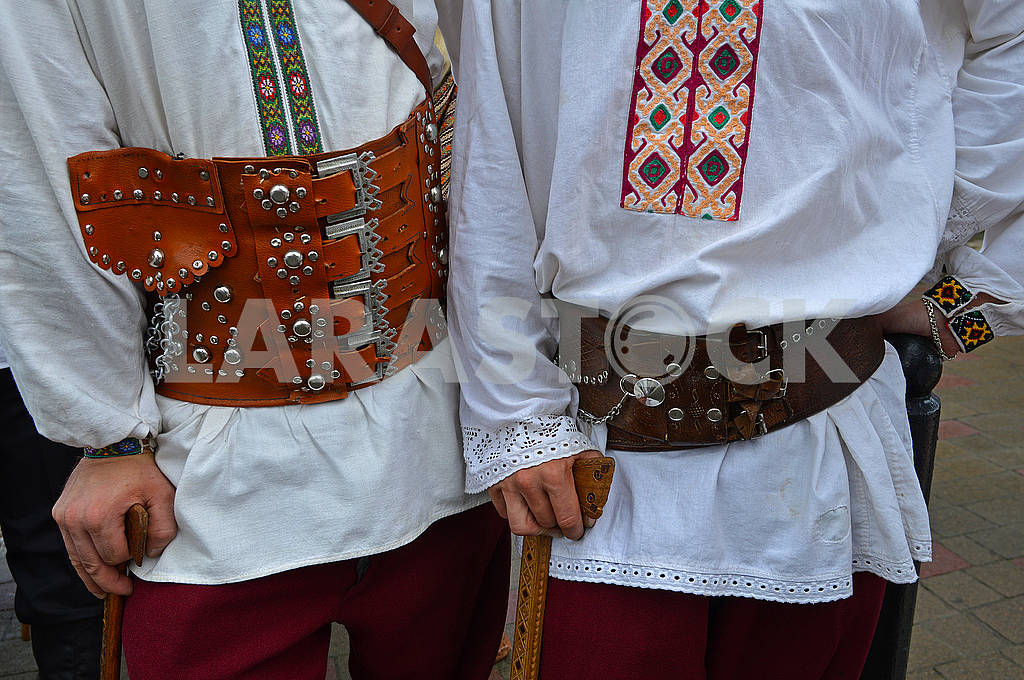 Two men in wide leather belts — Image 72992