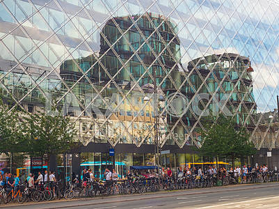 Reflection in the showcase and bicyclists in Copenhagen