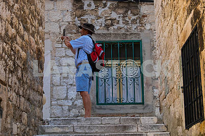 A man takes a selfie in Sibenik
