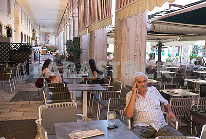 Elderly man in a cafe