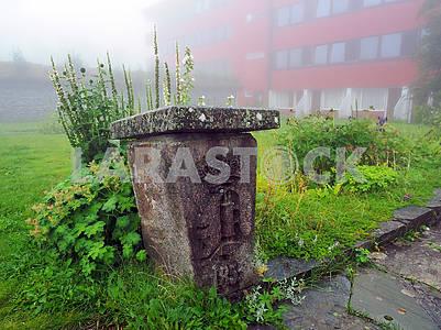 Runestone and morning fog