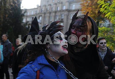 Participants in the parade of zombies