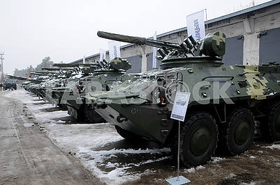 The snow removal machine cleans the yard of the Kiev Armored Plant