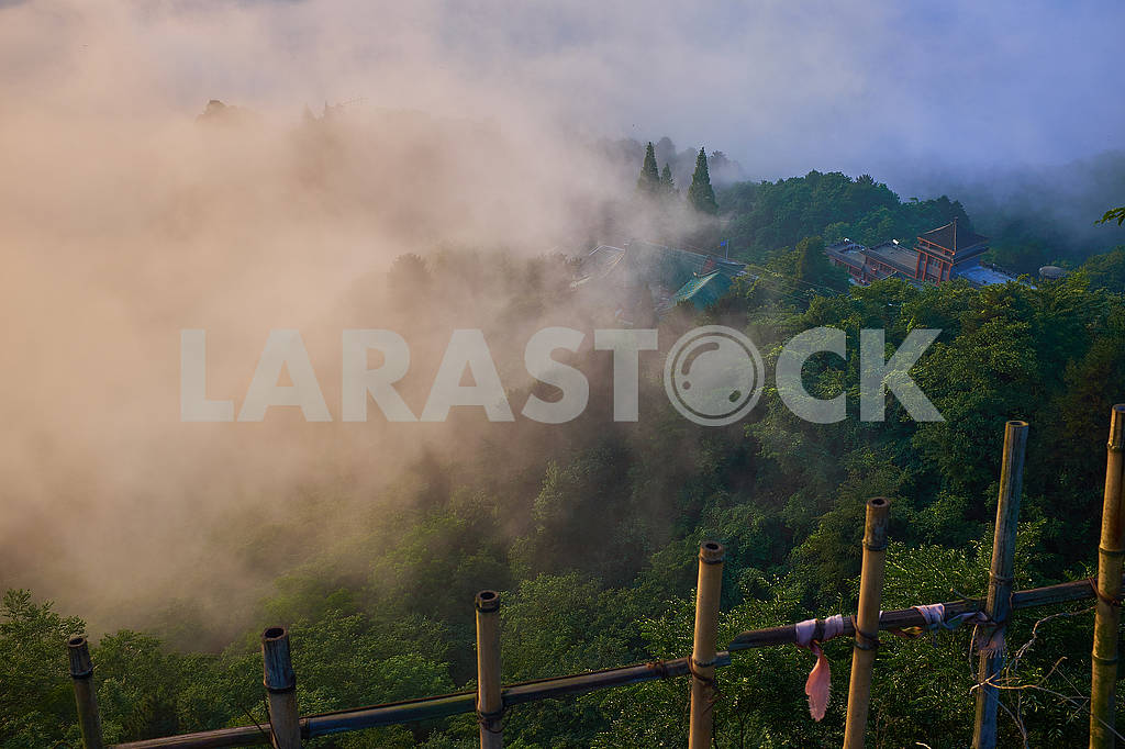 Foggy sunrise on top of mountain over the ancient asian building — Image 76212