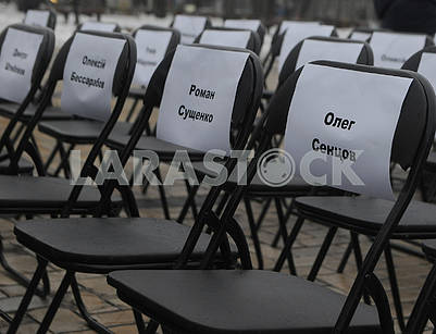 Empty chairs with the names of prisoners in Russia and the Crimea and prisoners in ORDLO