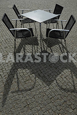 Metal square table and four armchairs