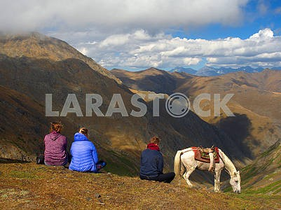 Tourists and horse on the pass