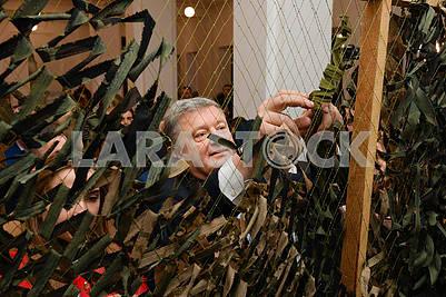 Petro Poroshenko knits camouflage nets