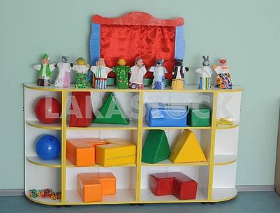Bookshelf with toys