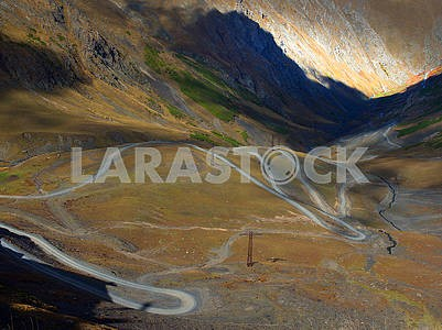 Winding road in a hollow in the Caucasus