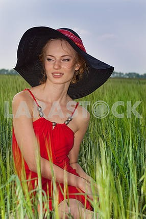 Portrait of a beautiful young woman in a white hat