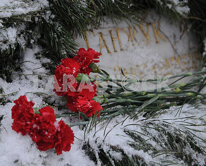 "Flowers at the memorial sign ""To the Soldiers of Chernobyl"""