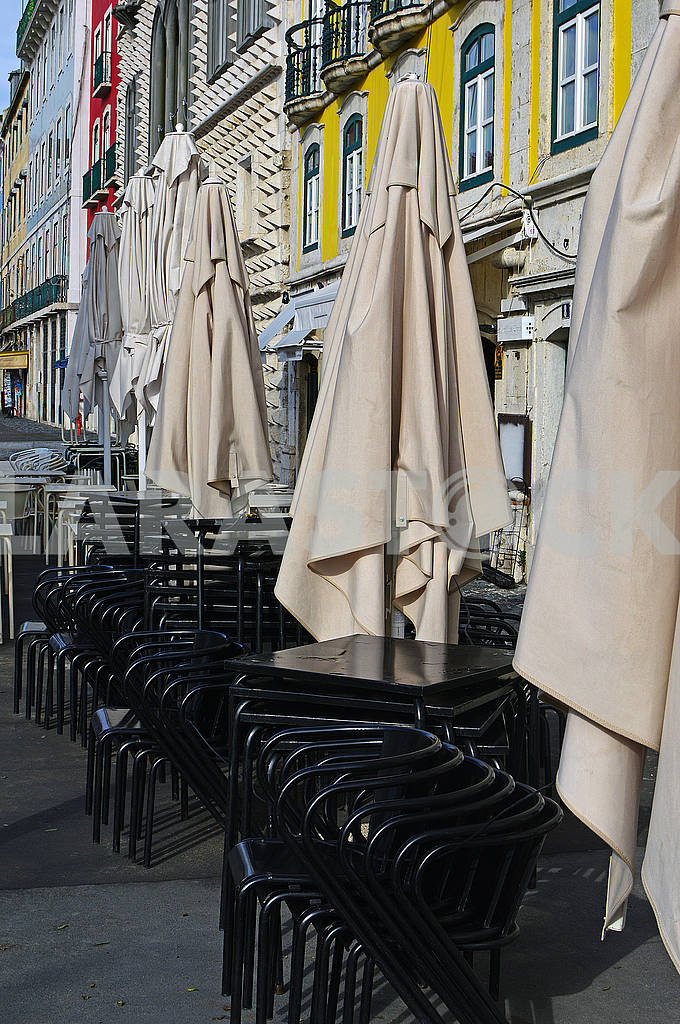 Folded umbrellas, chairs and tables of the restaurant — Image 77508