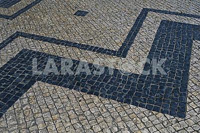 Traditional portuguese stone mosaic calcade in Lisbon