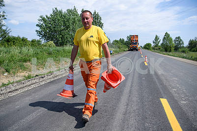Worker carries cones