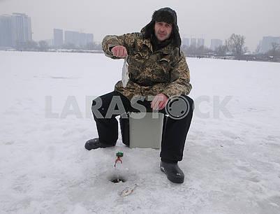 Fisherman holds caught fish