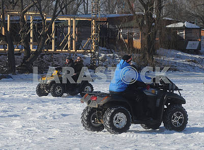 People ride quad bikes
